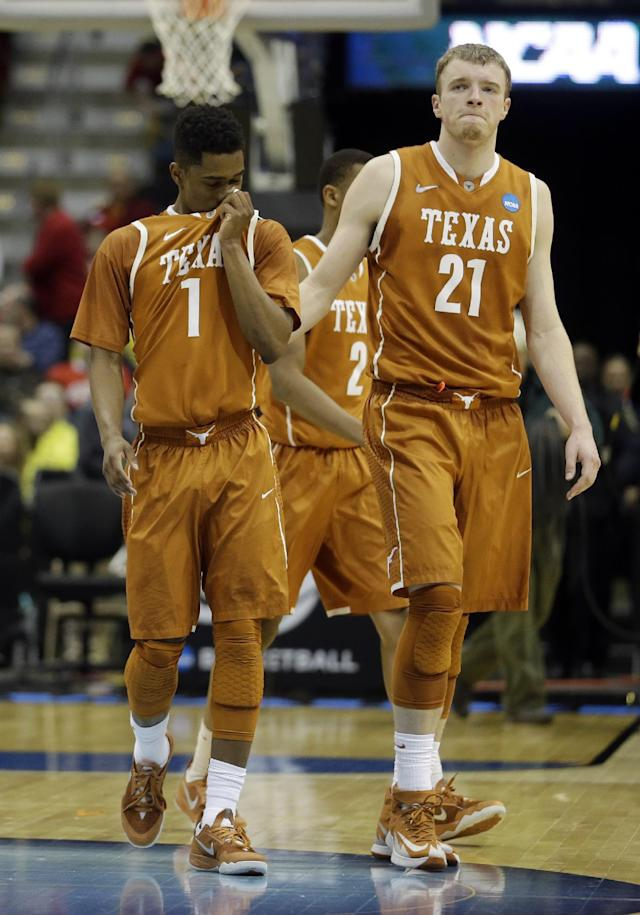 Texas guard Isaiah Taylor (1) and forward Connor Lammert (21) walk off the court after a third-round game of the NCAA college basketball tournament Saturday, March 22, 2014, in Milwaukee. Michigan won 79-65. (AP Photo/Morry Gash)