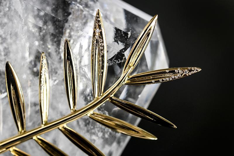 The 70th anniversary special edition of the Palme d'Or trophy pictured ahead of the Cannes Film Festival, during a photocall at the Chopard Jewellery House in Geneva on April 26, 2017 (AFP Photo/Fabrice COFFRINI)