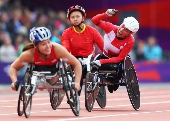 Edith Wolf of Switzerland celebrates winning gold in the Women's 5000m T54 Final on day 4 of the London 2012 Paralympic Games at Olympic Stadium on September 2, 2012 in London, England. (Photo by Michael Steele/Getty Images)