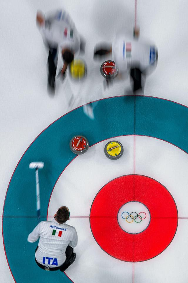 <p>Italian team competes during the curling men's round robin session between Canada and Italy at the Pyeongchang 2018 Winter Olympic Games at the Gangneung Curling Centre in Gangneung on February 14, 2018. / AFP PHOTO / François-Xavier MARIT </p>