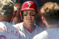 Philadelphia Phillies' Nick Maton is congratulated after hitting his first major league home run in the fifth inning of a baseball game against the Toronto Blue Jays Sunday, May 16, 2021, in Dunedin, Fla. (AP Photo/Mike Carlson)