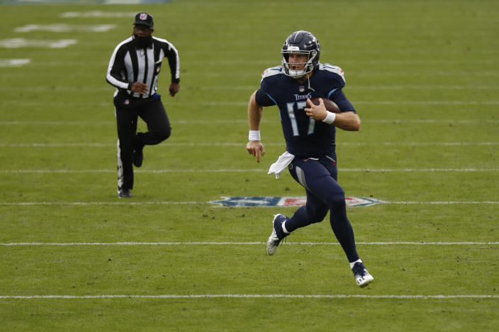Tennessee Titans quarterback Ryan Tannehill runs for a touchdown against the Detroit Lions during the first half of an NFL football game Sunday, Dec. 20, 2020, in Nashville, N.C. (AP Photo/Wade Payne)