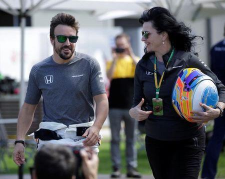 Formula One - F1 - Australian Grand Prix - Melbourne, Australia - 23/03/2017 McLaren driver Fernando Alonso of Spain (L) walks to the driver portrait session at the first race of the year. REUTERS/Jason Reed