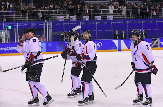 The Unified Korea team players thank the fans after the women's ice hockey game between the Unified Korea team and Sweden during the Pyeongchang 2018 Winter Olympic Games. (Getty Images)