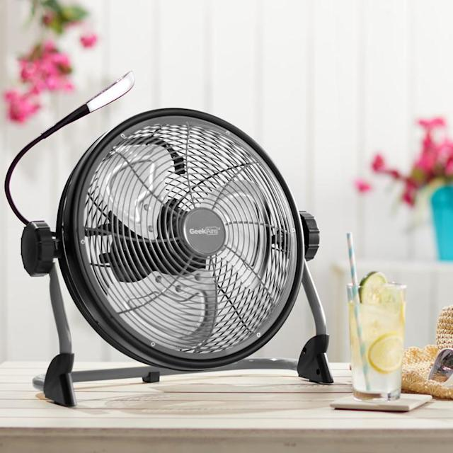 """TheGeek Aire 12"""" Rechargeable Water-Resistant Fan with LED Light comes in grey or yellow."""