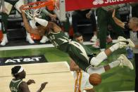 Milwaukee Bucks' Giannis Antetokounmpo dunks during the first half of Game 1 of the NBA Eastern Conference basketball finals game against the Atlanta Hawks Wednesday, June 23, 2021, in Milwaukee. (AP Photo/Morry Gash)