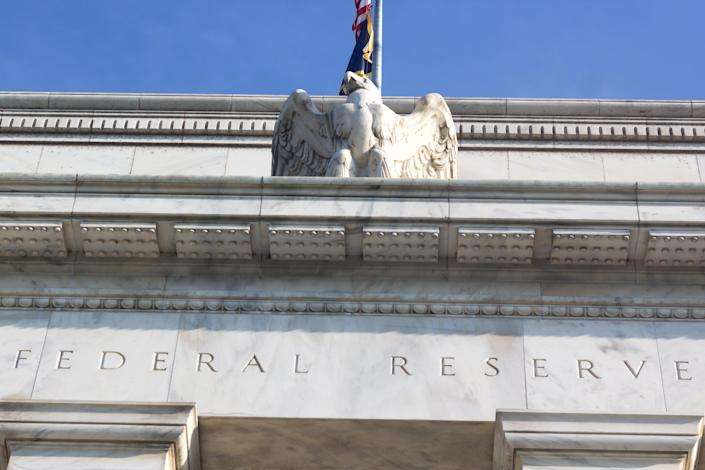Close up of the Federal Reserve building with the eagle statue.