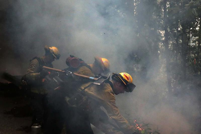 Fire crews have faced an uphill struggle to contain the blazes (AP)