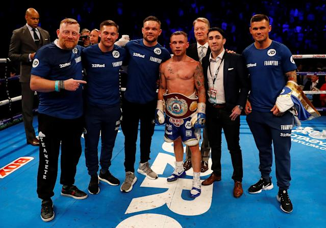 Boxing - Carl Frampton v Nonito Donaire - WBO Interim Featherweight World Title - SSE Arena, Belfast, Britain - April 21, 2018 Carl Frampton celebrates with the belt and his team after winning the fight Action Images via Reuters/Jason Cairnduff