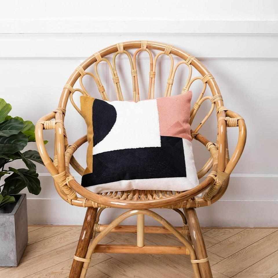 <p>We love the print on this <span>Embroidered Abstract Art Decorative Pillow Cover</span> ($13).</p>