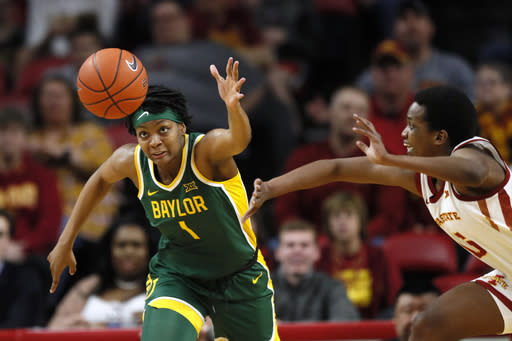 FILE- In this March 8, 2020, file photo, Baylor forward NaLyssa Smith, left, fights for the ball with Iowa State forward Ins Nezerwa, right, during the second half of an NCAA college basketball game in Ames, Iowa. Smith, who led the Big 12 with her 58.6% field goal shooting while averaging 14.3 points and 8.0 rebounds a game last season, is the preseason Big 12 player of the year. (AP Photo/Charlie Neibergall, File)