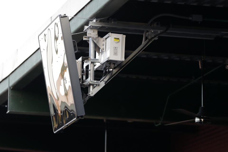 FILE - In this July 10, 2019, file photo, a radar device is attached to the roof behind home plate at PeoplesBank Park during the third inning of the Atlantic League All-Star minor league baseball game in York, Pa. Computer umpires for balls and strikes are coming to a low-level minor league but are a while away from the big leagues. Major League Baseball plans to use Automated Ball-Strike technology (ABS) in eight of nine ballparks at the Low-A Southeast League, which starts play May 4 across Florida as minor league baseball resumes after a one-year break caused by the coronavirus pandemic. (AP Photo/Julio Cortez, File)