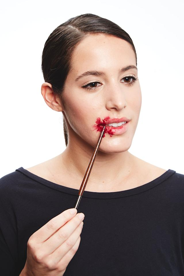 <p>Apply the thick blood mixture using the end of your makeup brush, which is easier to wipe clean than the bristles.</p>