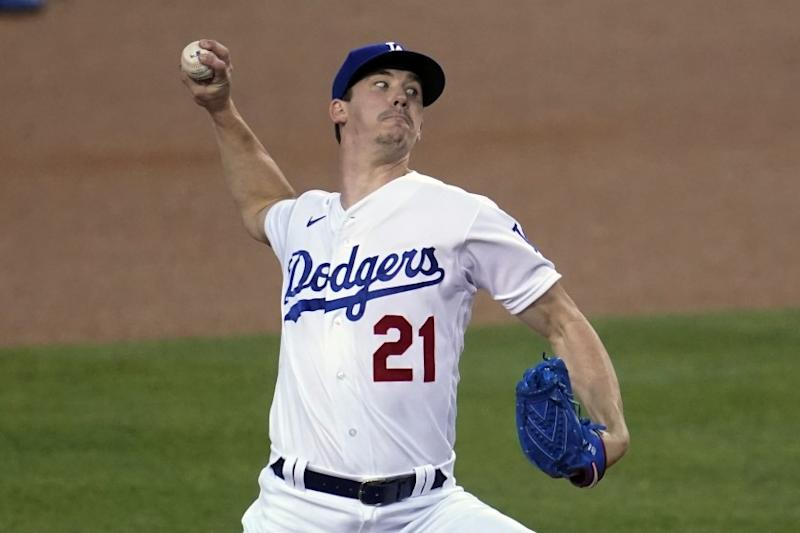 Los Angeles Dodgers starter Walker Buehler throws to an Oakland Athletics batter during the first inning.