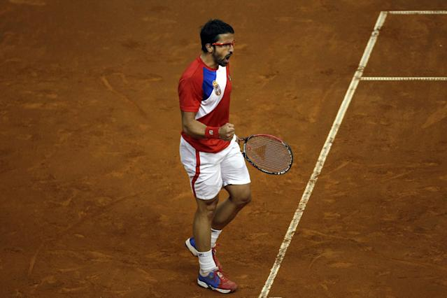 Serbia's Janko Tipsarevic clinches his fist as he celebrates winning a point against Canada's Milos Raonic during their Davis Cup semifinals tennis match in Belgrade, Serbia, Friday, Sept. 13, 2013. (AP Photo/ Marko Drobnjakovic)