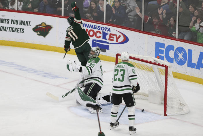Minnesota Wild's Zach Parise celebrates after scoring a goal against Dallas Stars goalie Ben Bishop during the third period of an NHL hockey game Saturday, Jan. 18, 2020, in St. Paul, Minn. Minnesota won 7-0. (AP Photo/Stacy Bengs)