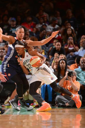 NEW YORK, NY - AUGUST 8: Swin Cash #32 of the New York Liberty drives against the Connecticut Sun during the game on August 8, 2014 at Madison Square Garden in New York, New York. (Photo by Jesse D. Garrabrant/NBAE via Getty Images)