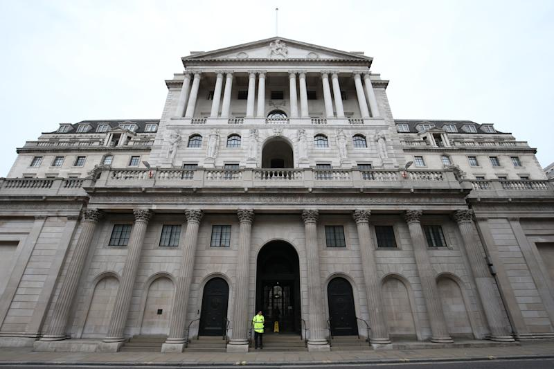 A lone security guard stands outside the Bank of England, in the City of London, as the UK's coronavirus death toll reached 144 as of 1pm on Thursday, with around four in 10 of all deaths so far in London.