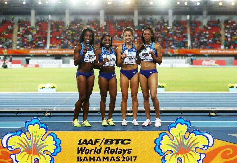 Chanelle Price, Chrishuna Williams, Laura Roesler and Charlene Lipsey of team USA pose on the podium after placing first in the 4x800m relay during the IAAF/BTC World Relays Bahamas 2017, at Thomas Robinson Stadium in Nassau, on April 22