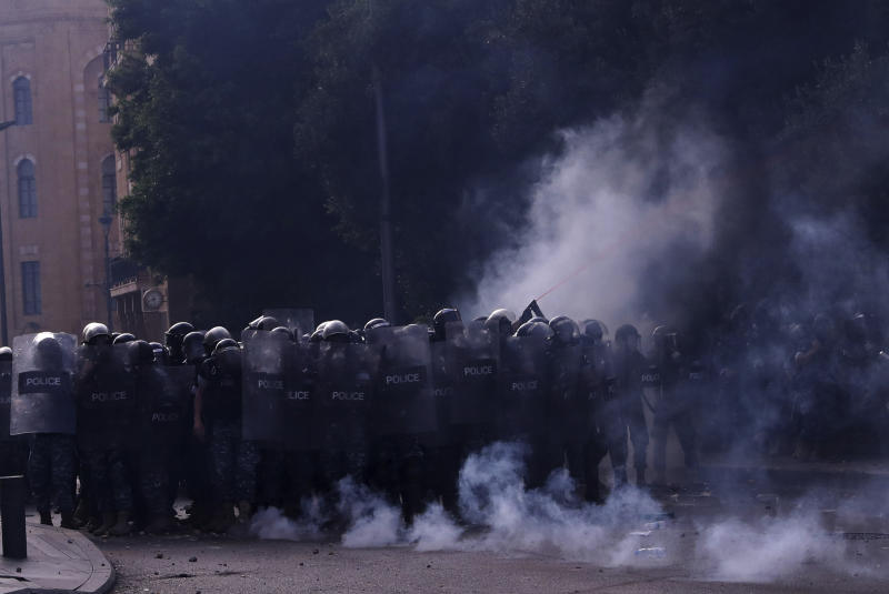 Lebanese riot policemen clash with anti-government protesters during ongoing protests against the Lebanese government, in downtown Beirut, Lebanon, Saturday, June 6, 2020. Hundreds of Lebanese demonstrators gathered in central Beirut Saturday, hoping to reboot nationwide anti-government protests that began late last year amid an unprecedented economic and financial crisis. (AP Photo/Bilal Hussein)