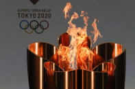 The celebration cauldron is seen lit on the first day of the Tokyo 2020 Olympic torch relay in Naraha, Fukushima prefecture, northeastern Japan, Thursday, March 25, 2021. The torch relay for the postponed Tokyo Olympics began its 121-day journey across Japan on Thursday and is headed toward the opening ceremony in Tokyo on July 23. (Kim Kyung-Hoon/Pool Photo via AP)