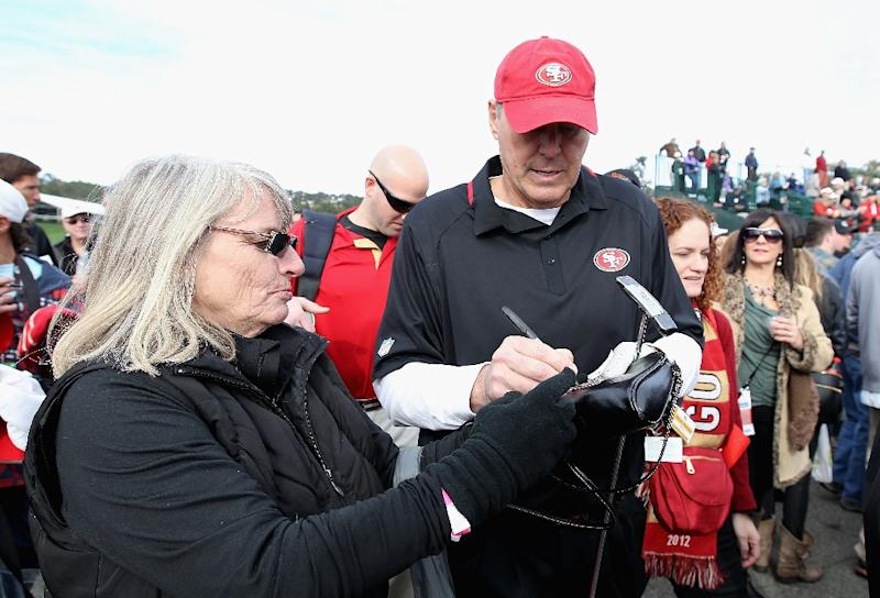 Former San Francisco 49ers wide receiver, Dwight Clark, signs autographs for fans at Pebble Beach Golf Links in California, in 2014