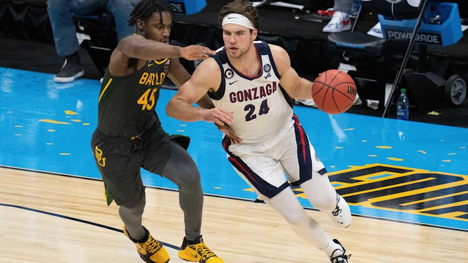 April 5, 2021; Indianapolis, IN, USA; Gonzaga Bulldogs forward Corey Kispert (24) dribbles the basketball against Baylor Bears guard Davion Mitchell (45) in the second half during the national championship game in the Final Four of the 2021 NCAA Tournament at Lucas Oil Stadium. Mandatory Credit: Kyle Terada-USA TODAY Sports ORG XMIT: IMAGN-446986 ORIG FILE ID:  20210409_kkt_st3_248.jpg
