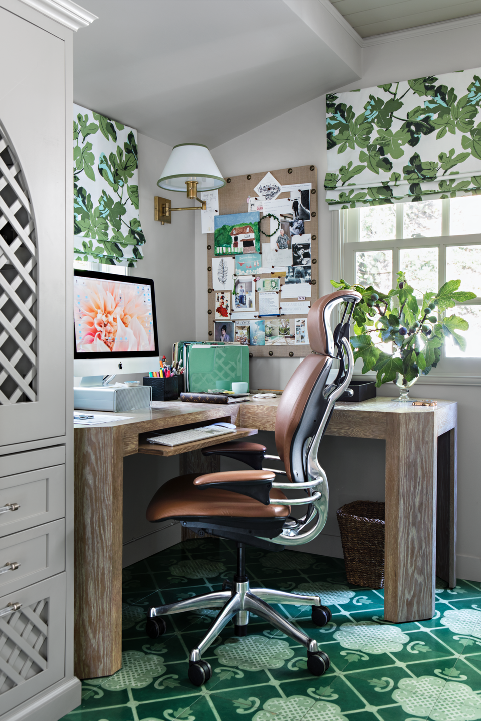 <p>Between the leaf-print window treatments and treillage-fronted cabinetry, this office feels like a secret garden—in fact, it was a porch before designer Joe Lucas enclosed the space.</p>