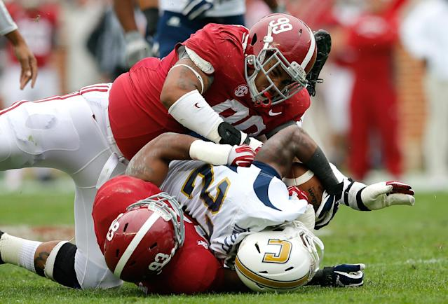 TUSCALOOSA, AL - NOVEMBER 23: Brandon Ivory #99 and Jonathan Allen #93 of the Alabama Crimson Tide tackle Kendrix Huitt #27 of the Chattanooga Mocs at Bryant-Denny Stadium on November 23, 2013 in Tuscaloosa, Alabama. (Photo by Kevin C. Cox/Getty Images)