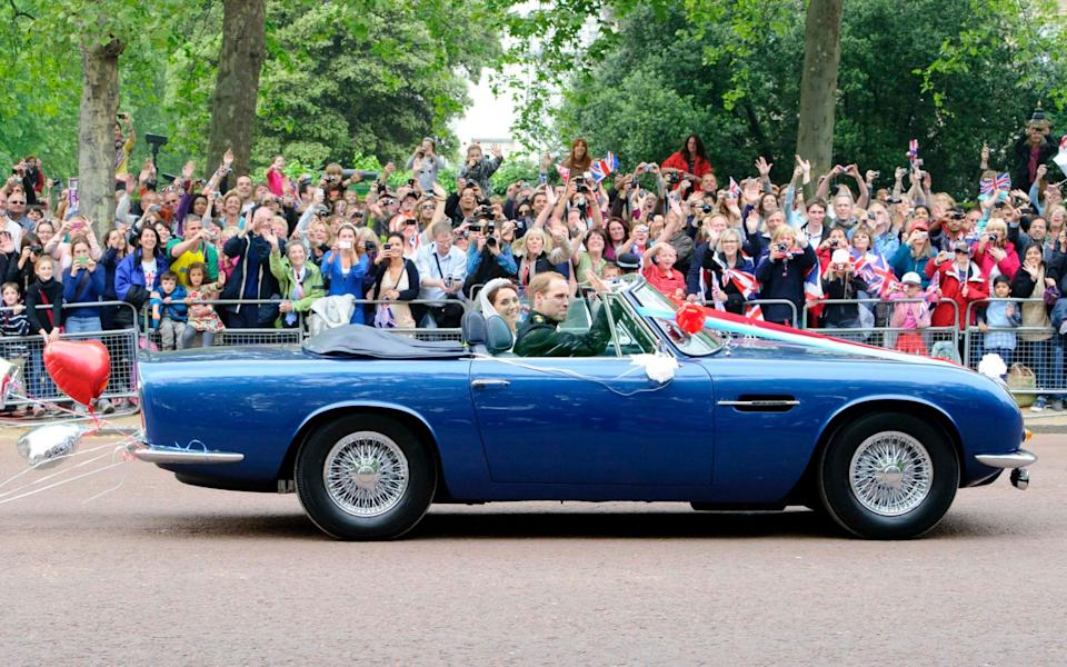 Prince William drives his wife, Kate, Duchess of Cambridge in Prince Charles' Aston Martin DB6 Volante after their wedding - Jonathan Short/AP