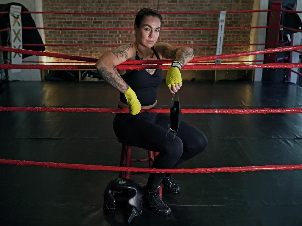 "Melody ""Mel"" Popravak, a boxer, poses for a portrait at Work Train Fight boxing gym, Friday, March 5, 2021, in New York. After the coronavirus shutdown, she trained in a friend's garage. ""I'm determined not to give up and to continue to move on to be a professional boxer,"" the 35-year-old said. (AP Photo/Kathy Willens)"