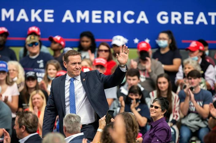 U.S. Rep. Ted Budd waves to the crowd during a campaign event at the Piedmont Triad International Airport in Greensboro, N.C., Tuesday, Oct. 27, 2020.