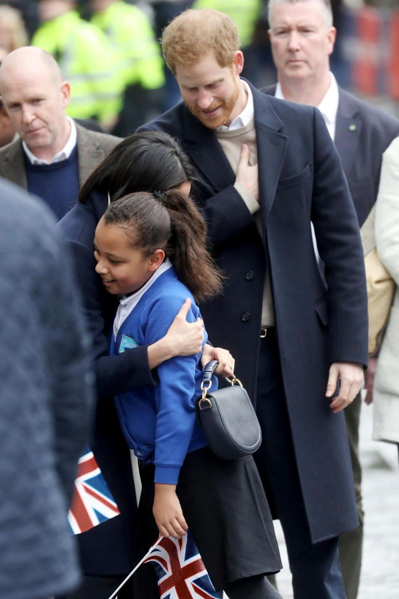 The young girl couldn't believe her luck when Prince Harry pulled her out of the crowd. Photo: Getty Images
