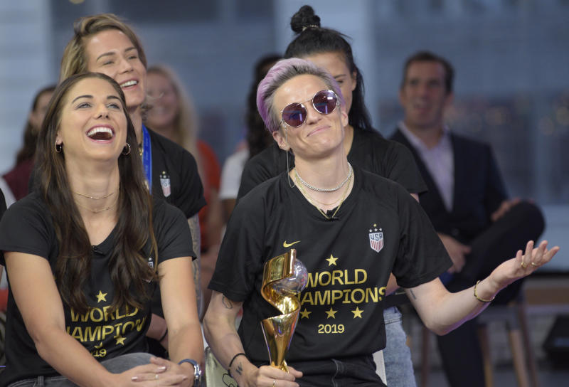 """GOOD MORNING AMERICA - 7/9/19 The United States Women's National Soccer Team celebrate their victory on """"Good Morning America,"""" Tuesday, July 9, 2019 on the Walt Disney Television Network. GMA19(Photo by Paula Lobo/Walt Disney Television via Getty Images) ALEX MORGAN, MEGAN RAPINOE"""
