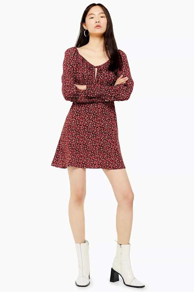 """<p>This <a href=""""https://www.popsugar.com/buy/Prairie-Floral-Mini-Dress-478984?p_name=Prairie%20Floral%20Mini%20Dress&retailer=us.topshop.com&pid=478984&price=75&evar1=fab%3Aus&evar9=46490147&evar98=https%3A%2F%2Fwww.popsugar.com%2Ffashion%2Fphoto-gallery%2F46490147%2Fimage%2F46490734%2FPrairie-Floral-Mini-Dress&list1=shopping%2Cfall%20fashion%2Cdresses&prop13=mobile&pdata=1"""" rel=""""nofollow"""" data-shoppable-link=""""1"""" target=""""_blank"""" class=""""ga-track"""" data-ga-category=""""Related"""" data-ga-label=""""https://us.topshop.com/en/tsus/product/clothing-70483/dresses-70497/prairie-floral-mini-dress-9018617"""" data-ga-action=""""In-Line Links"""">Prairie Floral Mini Dress </a> ($75) will look cute with black tights.</p>"""