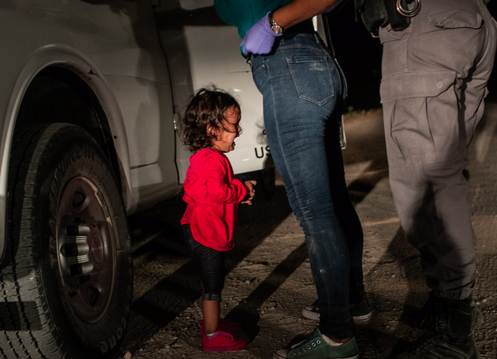 <p>Yana, from Honduras, cries as her mother Sandra Sanchez is searched by a US Border Patrol agent, in McAllen, Texas, USA. (John Moore) </p>