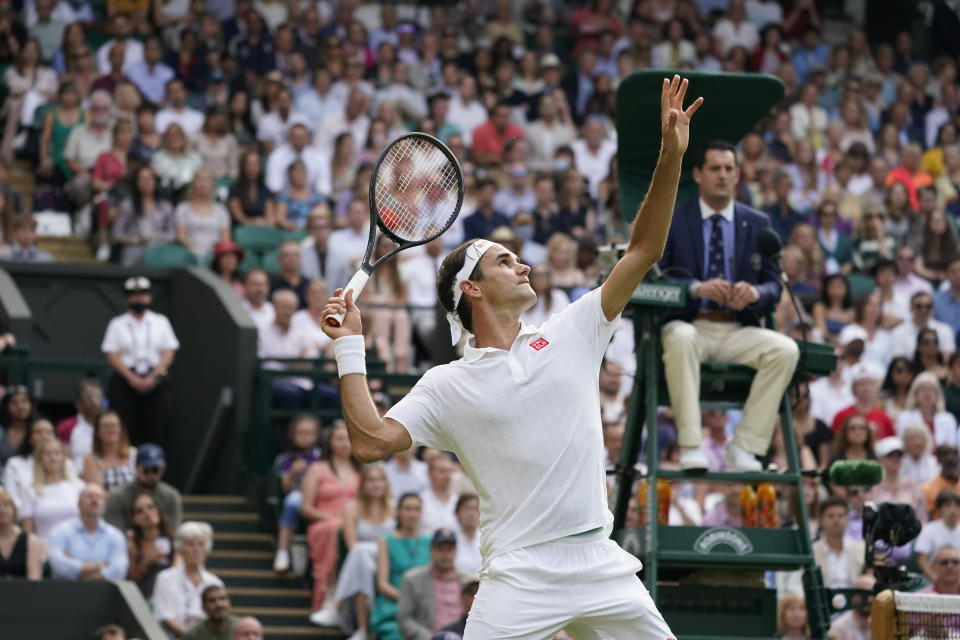 Switzerland's Roger Federer serves to Richard Gasquet of France during the men's singles second round match on day four of the Wimbledon Tennis Championships in London, Thursday July 1, 2021. (AP Photo/Alberto Pezzali)