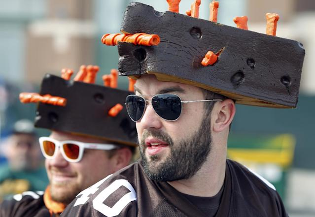 Cleveland Browns fans Paul Beeson, right, and Jared Botimer tailgate outside Lambeau Field before an NFL football game against the Green Bay Packers Sunday, Oct. 20, 2013, in Green Bay, Wis. (AP Photo/Mike Roemer)