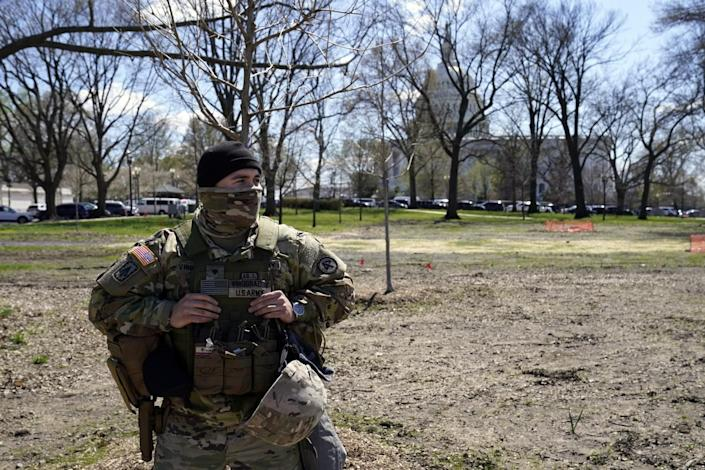 A member of the National Guard patrols near the U.S. Capitol after a car crashed into a barrier on Capitol Hill