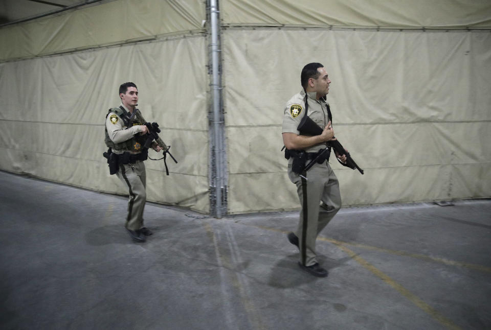 <p>Police officers enter the Mandalay Bay resort and casino during the shooting (AP) </p>