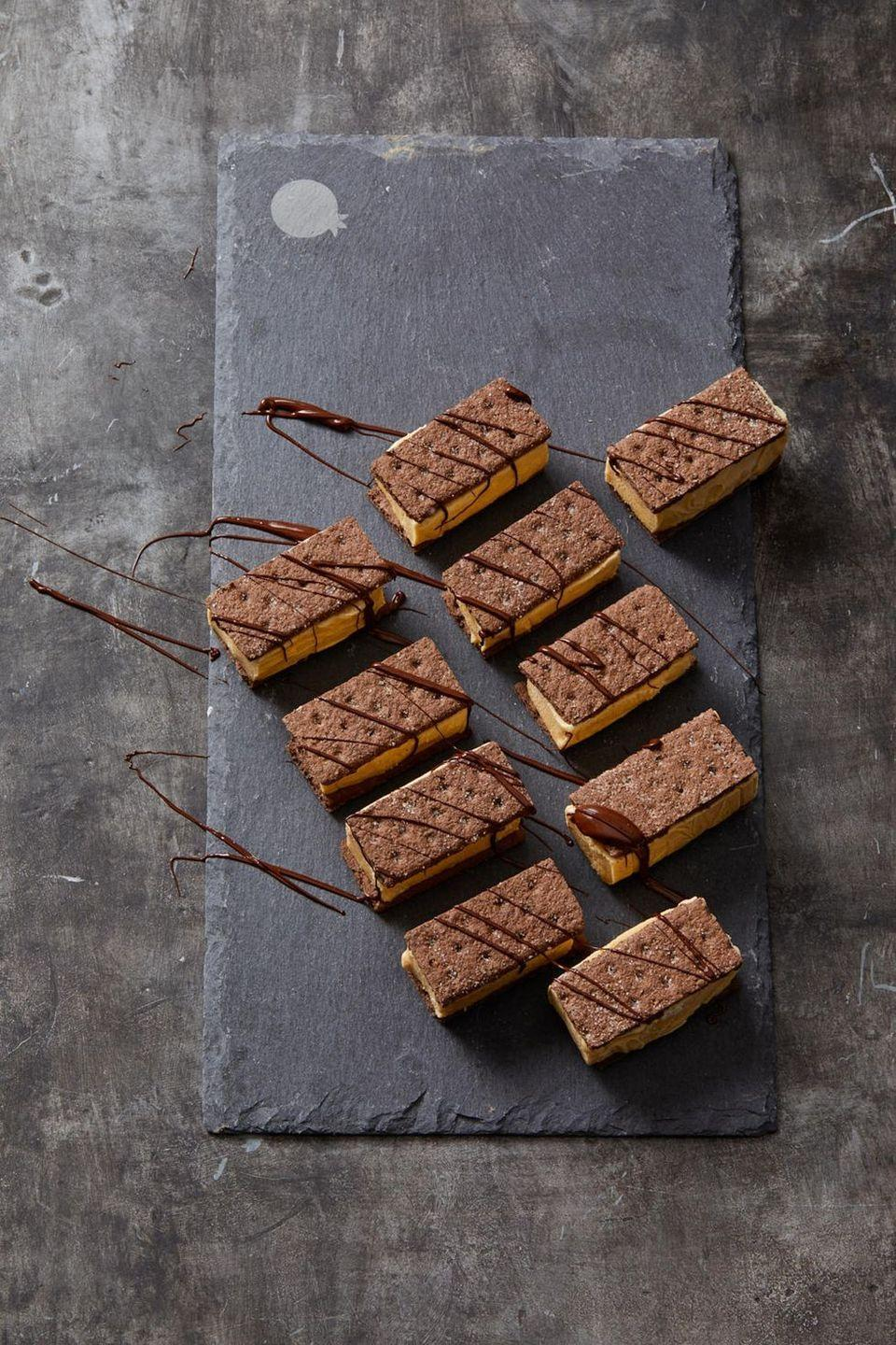 """<p>Pumpkin ice cream and chocolate graham crackers make an easy, 3-ingredient Halloween (or anytime!) dessert.</p><p><em><a href=""""https://www.goodhousekeeping.com/food-recipes/a28542349/chocolate-and-pumpkin-ice-cream-sandwiches-recipe/"""" rel=""""nofollow noopener"""" target=""""_blank"""" data-ylk=""""slk:Get the recipe for Chocolate and Pumpkin Ice Cream Sandwiches »"""" class=""""link rapid-noclick-resp"""">Get the recipe for Chocolate and Pumpkin Ice Cream Sandwiches »</a></em></p><p><strong>RELATED: </strong><a href=""""https://www.goodhousekeeping.com/food-recipes/g3639/best-pumpkin-recipes/"""" rel=""""nofollow noopener"""" target=""""_blank"""" data-ylk=""""slk:47 Sweet and Savory Pumpkin Recipes to Make This Fall"""" class=""""link rapid-noclick-resp"""">47 Sweet and Savory Pumpkin Recipes to Make This Fall</a><br></p>"""