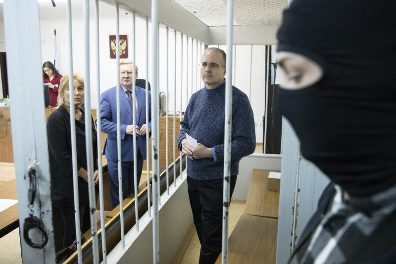 Paul Whelan, a former U.S. Marine, center, who was arrested in Moscow at the end of last year, waits for a hearing in a court in Moscow, Russia, Friday, May 24, 2019. The American was detained at the end of December for alleged spying. (AP Photo/Pavel Golovkin)