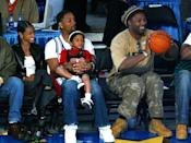 <p>Will Smith and Jada Pinkett Smith take their son Jaden to the 2004 NBA All-Star slam-dunk contest in L.A. (Boxer Lennox Lewis sits to the right.)</p>