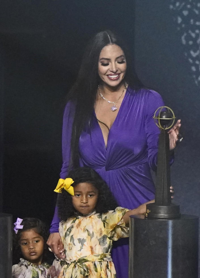 Vanessa Bryant, widow of Kobe Bryant, stands with daughters Capri and Bianka with Bryant's Basketball Hall of Fame award on Saturday, May 15, 2021, in Uncasville, Connecticut / Credit: Kathy Willens / AP