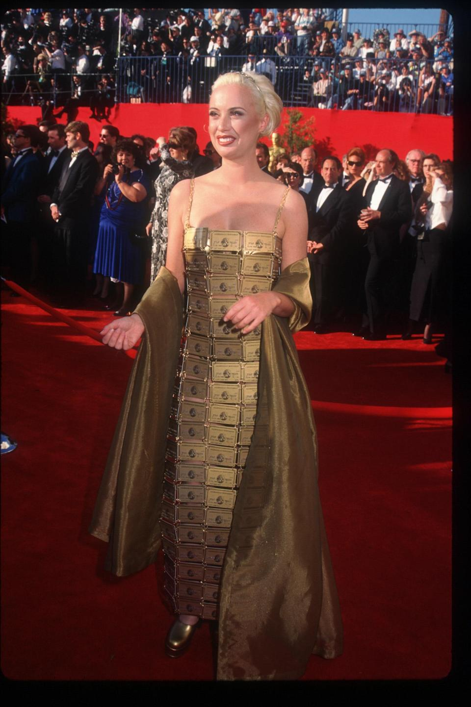 """Lizzy Gardiner, an Australian costume designer, won the Oscar for best costume design for <em>The Adventures of Priscilla.</em> She showed up to the red carpet in a dress that was made out of 254 American Express Gold cards, all joined together by wire. Gardiner explained that the dress was actually made for the movie, but it got vetoed, so she wore it to the carpet, because """"I'm broke, and I didn't have anything to wear."""" Gardiner also <a href=""""https://www.abc.net.au/news/2017-06-05/priscillas-1995-oscar-win-and-that-dress/8578418"""" rel=""""nofollow noopener"""" target=""""_blank"""" data-ylk=""""slk:later reflected"""" class=""""link rapid-noclick-resp"""">later reflected</a> on the look: """"On the night it really upset a lot of people. A lot of women, I think they felt upstaged or pissed off that I wasn't taking things as seriously as I should."""" Fashion fans loved its creativity, though, and Vaquera paid <a href=""""https://www.vogue.com/article/vaquera-credit-card-dress-lizzy-gardiner-spring-2018?mbid=synd_yahoo_rss"""" rel=""""nofollow noopener"""" target=""""_blank"""" data-ylk=""""slk:homage to it"""" class=""""link rapid-noclick-resp"""">homage to it</a> back in 2017."""