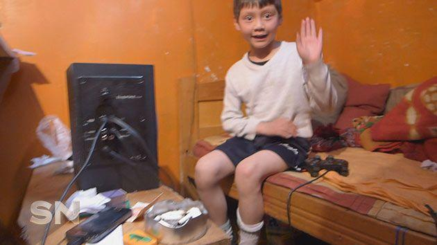 A boy plays in his 'apartment'