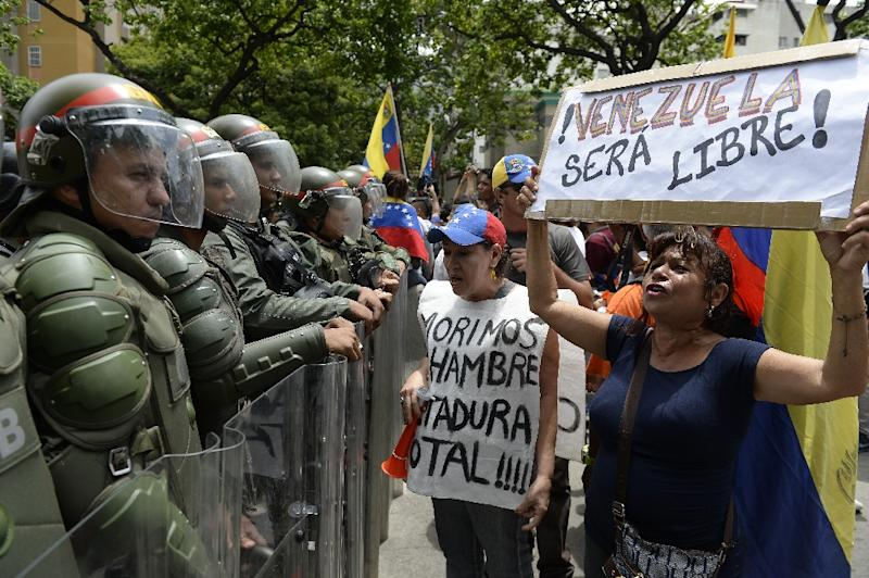 People protest against new emergency powers decreed by President Nicolas Maduro in Caracas on May 18, 2016