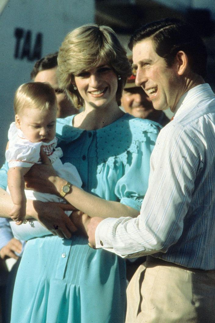 <p>Princess Diana carries a baby Prince William as she and Prince Charles arrive to Alice Springs, Australia. </p>