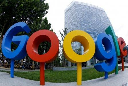 FILE PHOTO: The brand logo of Alphabet Inc's Google is seen outside its office in Beijing, China August 8, 2018. REUTERS/Thomas Peter/File Photo