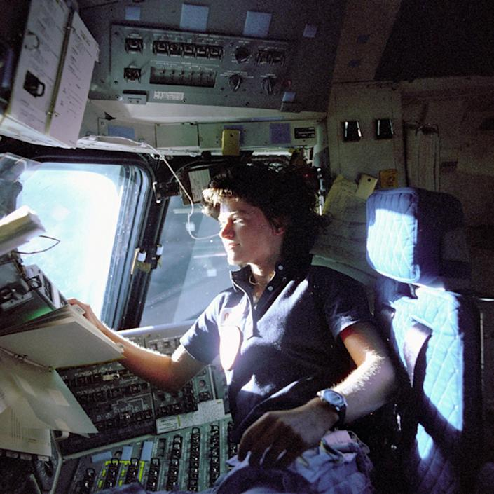 FILE - In this June 1983 photo released by NASA, astronaut Sally Ride, a specialist on shuttle mission STS-7, monitors control panels from the pilot's chair on the shuttle Columbia flight deck. Ride, the first American woman in space, died Monday, July 23, 2012 after a 17-month battle with pancreatic cancer. She was 61. (AP Photo/NASA, File)